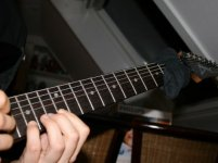 The old wrap-a-sock-around-the-guitar-neck-for-crazy-tapping-parts trick